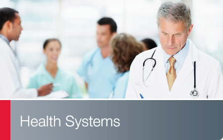 Health Systems - Physician in foreground with clinical staff behind