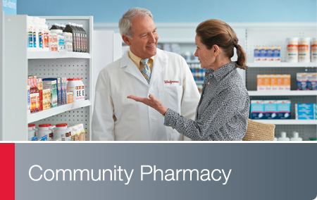 Community Pharmacy - Walgreens pharmacist assisting customer in the store